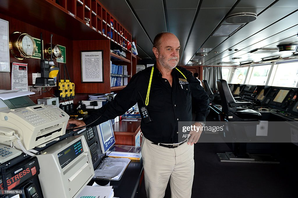 Rescue co-ordinator Don McIntyre shows the Global Maritime Distress Safety System (GMDSS) on the bridge of the Antarctic cruise vessel which rescued French sailor Alian Delord, the MV Orion, at Macquarie dock, in Hobart on January 22, 2013. A French sailor walked off the cruise ship that saved him after he spent three days adrift in a life-raft in the remote Southern Ocean, smiling and assisted by his rescuers. Alain Delord was marooned on a life-raft in mountainous seas about 500 nautical miles from southern Australia's Tasmania after his yacht was badly damaged in perilous weather during a solo round-the-world sailing attempt.