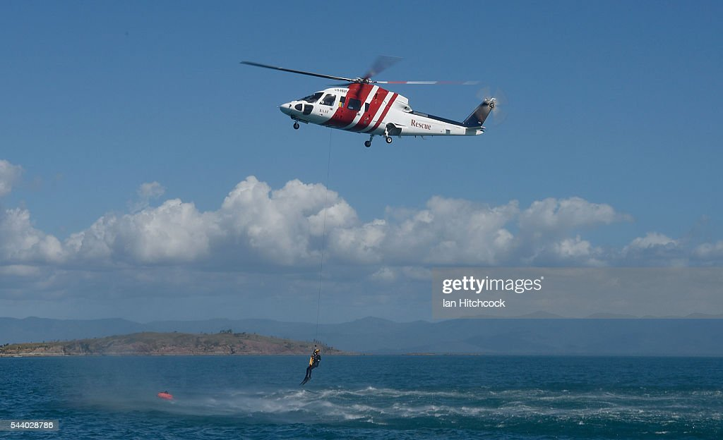 A rescue crewman from the Royal Australian Air Force (RAAF) search and rescue helicopter is seen approaching a simulated aircraft crash survivor during Exercise Angel Reign on July 1, 2016 in Townsville, Australia. Exercise Angel Reign is the largest Air Force led field exercise in Australia this year and is a bilateral Joint Personnel Recovery exercise which aims to practice search and rescue activities both at sea and on land.