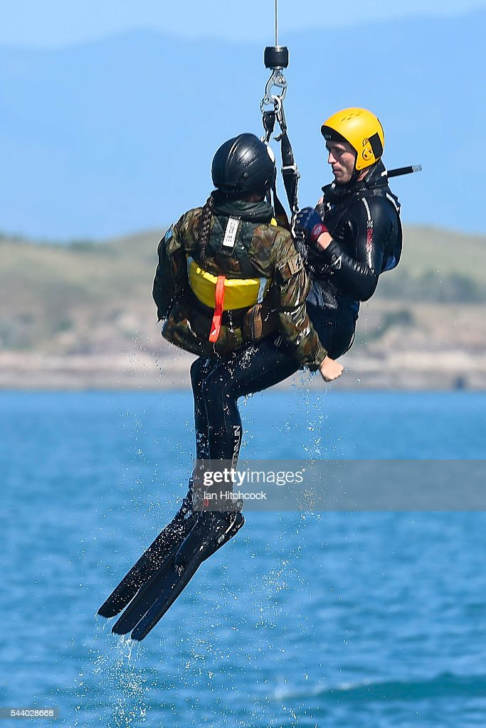 A rescue crewman is seen winching a simulated aircraft crash survivor up out of the ocean into the Royal Australian Air Force (RAAF) search and rescue helicopter during Exercise Angel Reign on July 1, 2016 in Townsville, Australia. Exercise Angel Reign is the largest Air Force led field exercise in Australia this year and is a bilateral Joint Personnel Recovery exercise which aims to practice search and rescue activities both at sea and on land.
