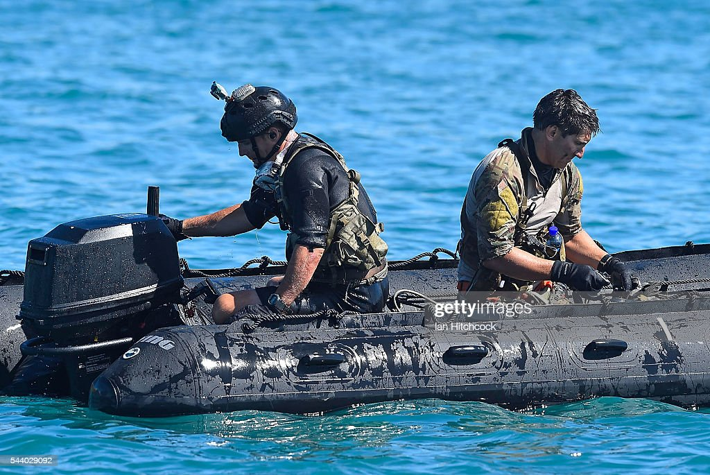 Rescue crewman that where deployed from a U.S military HH-60 Pave Hawk Helicopter are seen securing and starting the outboard motor of a rescue boat during Exercise Angel Reign on July 1, 2016 in Townsville, Australia. Exercise Angel Reign is the largest Air Force led field exercise in Australia this year and is a bilateral Joint Personnel Recovery exercise which aims to practice search and rescue activities both at sea and on land.