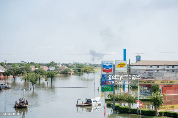 Rescue crews assist residents in Port Arthur Texas on Thursday September 1 2017 Houston was limping back to life on Friday one week after Hurricane...