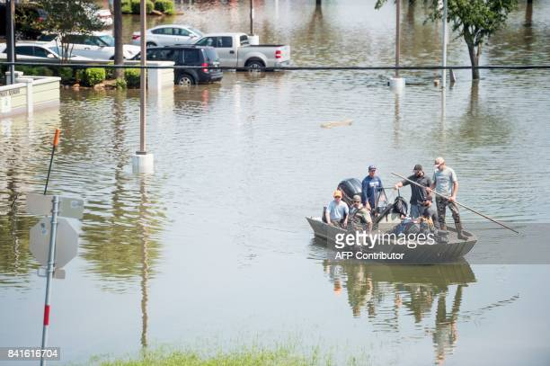 Rescue crews help flood victims in Port Arthur Texas on September 1 2017 Houston was limping back to life on Friday one week after Hurricane Harvey...