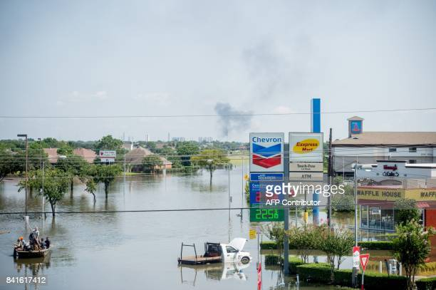 Rescue crews save residents in Port Arthur Texas on September 1 2017 Houston was limping back to life on Friday one week after Hurricane Harvey...