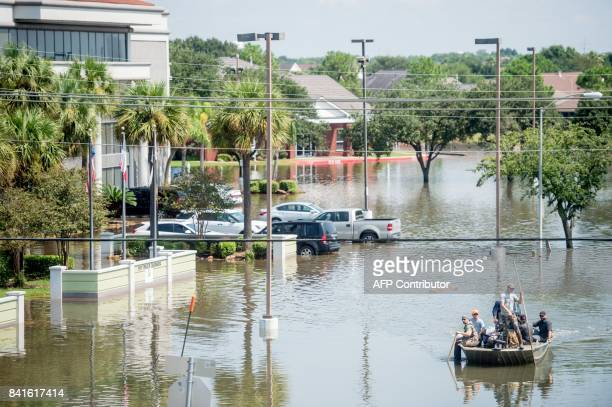 TOPSHOT Rescue crews save residents in Port Arthur Texas on September 1 2017 Houston was limping back to life on Friday one week after Hurricane...