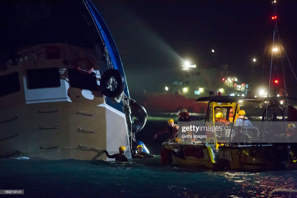 Rescue crews search for passengers in waters near Yung Shue Wan on Lamma Island on October 1, 2012 in Hong Kong. Twenty-five passengers were killed and several others were injured when a Hong Kong Electric ferry, carrying 124 people, collided with a tug boat off the coast of Hong Kong late on Monday.