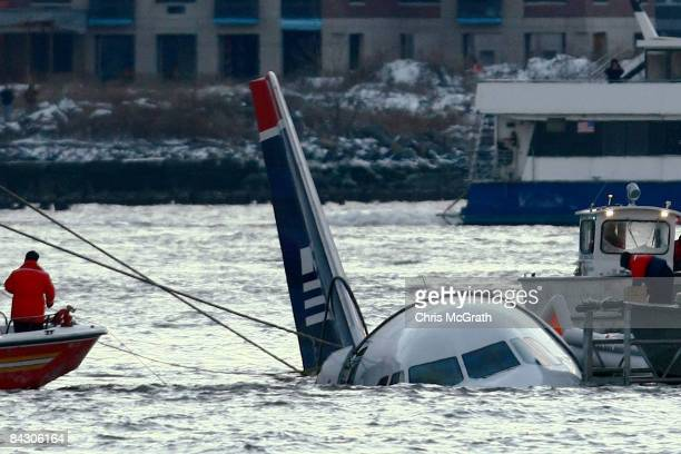 Rescue crews secure a US Airways flight 1549 floating in the water after it crashed into the Hudson River January 15 2009 in New York City The Airbus...