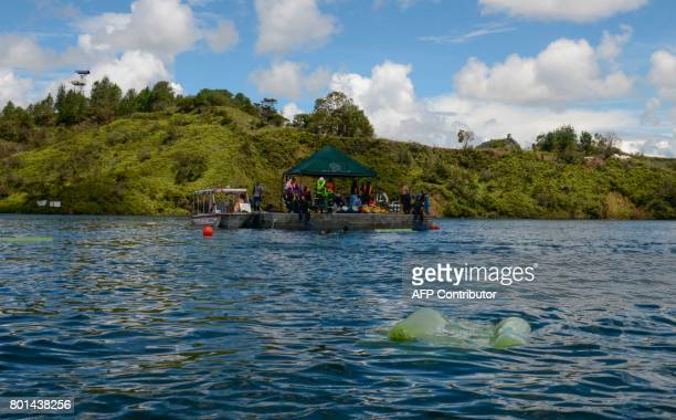 Rescue divers take part in the search of bodies of victims after the tourist boat 'Almirante' sank in the Reservoir of Penol in Guatape municipality...
