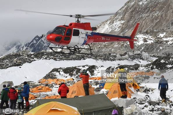 A rescue helicopter comes in for a landing to pick up the injured from Everest Base Camp on April 26 a day after an avalanche triggered by an...