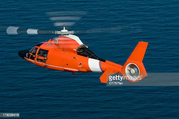 Rescue helicopter in action at sea