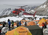 A rescue helicopter prepares to land and airlift the injured from Everest Base Camp on April 26 a day after an avalanche triggered by an earthquake...