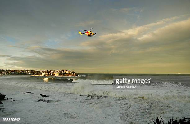A rescue helicopter search for a missing person at Bondi beach on June 6 2016 in Sydney Australia Torrential rain over the weekend saw streets and...