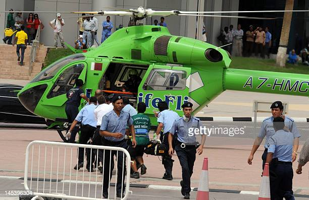 A rescue helicopter waits to transport victims to hospital outside Doha's Villagio Mall after a fire broke out at the Gulf emirate's main shopping...