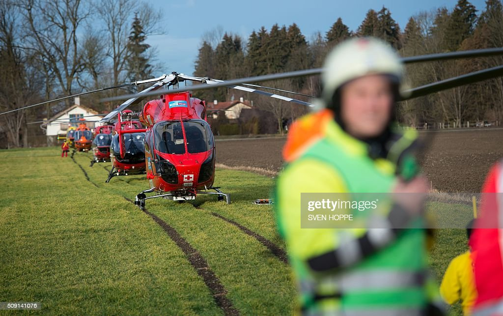 Rescue helicopters are ready to fly to the site of a train accident on February 9, 2016 near Bad Aibling, southern Germany. Two commuter trains collided near Bad Aibling, around 60 kilometres (40 miles) southeast of Munich, killing at least four people and injuring around 100, police said. The cause of the accident was not immediately clear. / AFP / dpa / Sven Hoppe / Germany OUT