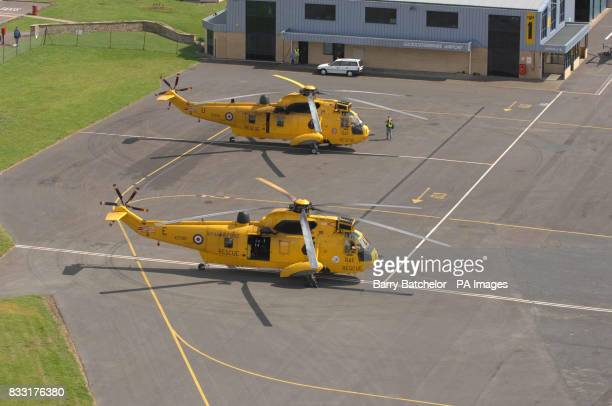 RAF Rescue helicopters sits on the tarmac at Gloucester airport Gloucestershire following torrential rain in the last 24 hours