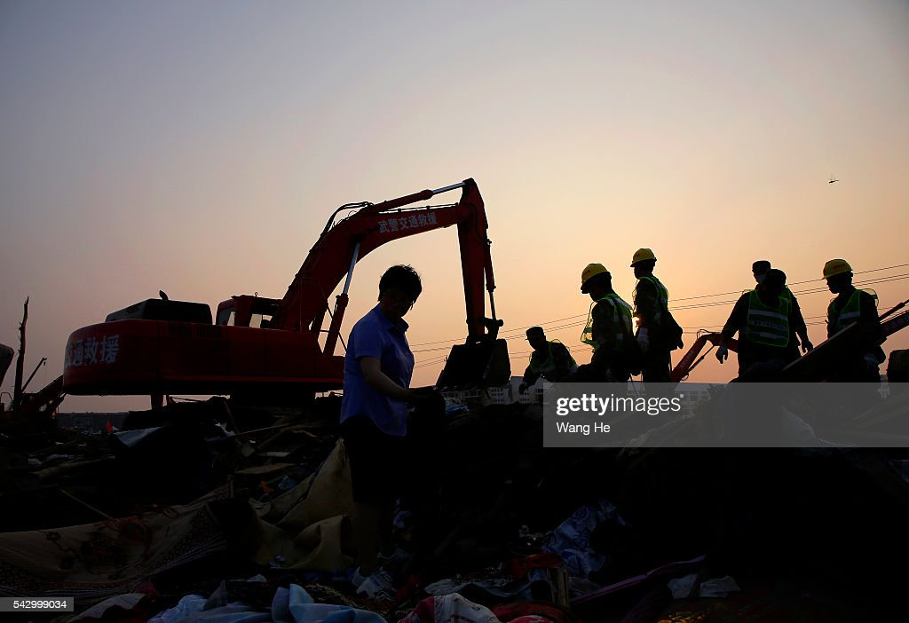 Rescue machinery is used to clean up damaged houses in Beichen Village of Chenliang Township in Funing, Yancheng, east China's Jiangsu Province on June 25, 2016. A total of 98 people were killed after severe storms in several towns in Jiangsu on Thursday, local rescue headquarters said on Friday. About 846 people sustained injuries, 200 of whom were seriously wounded, it said. More than 8,600 houses, two elementary schools and eight factory buildings were damaged in the counties of Funing and Sheyang, and parts of Yancheng City along the eastern coast of China. > on June 25, 2016 in Yancheng, China.