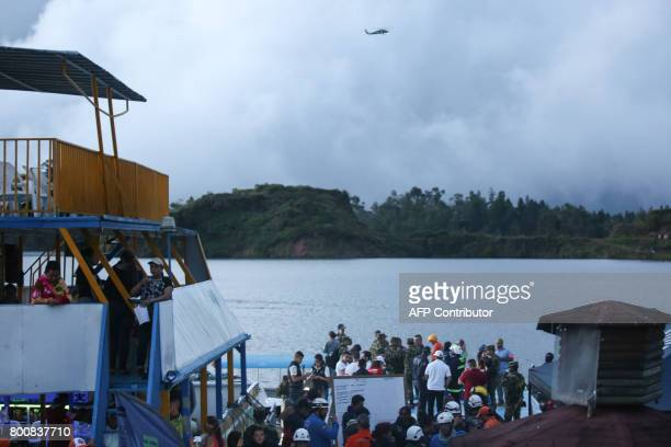 CORRECTION Rescue officials search for survivors after the tourist boat Almirante sank in the Reservoir of Penol in Guatape municipality in Antioquia...