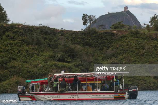 CORRECTION Rescue officials take part in a search for survivors after the tourist boat Almirante sank in the Reservoir of Penol in Guatape...