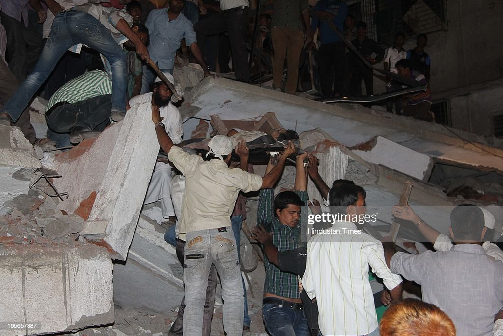 Rescue operation going at collapsed seven floor under-construction building at Lucky compound on April 4, 2013 in Thane, India. The death toll has risen to 39 while at least 69 people are injured. The building is illegal and constructed on Forest land. Police have registered a case against builders Salil and Khalil Jamadar under Section 304.