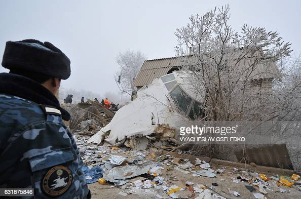 TOPSHOT Rescue personnel and investigators work at the crash site of a Turkish cargo plane in the village of DachaSuu outside Bishkek on January 17...