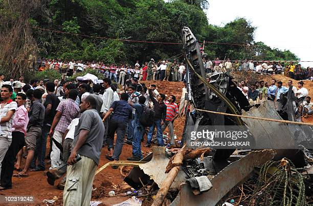 Rescue personnel and volunteers work at the crash site of an Air India Boeing 737800 aircraft which crashed upon landing in Mangalore on May 22 2010...
