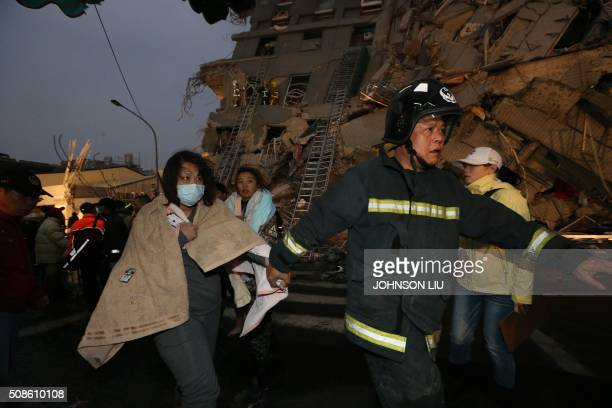 TOPSHOT Rescue personnel carry a survivor at the site of a collapsed building in the southern Taiwanese city of Tainan following a strong 64magnitude...