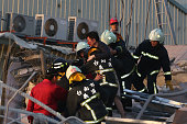Rescue personnel carry a survivor at the site of a collapsed building in the southern Taiwanese city of Tainan following a strong 64magnitude...