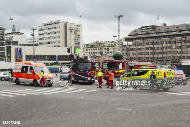 Rescue personnel have cordoned off the area at the Turku Market Square in the Finnish city of Turku where several people were stabbed on August 18...