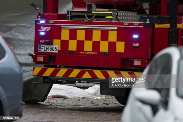 Rescue personnel have covered a stabbing victim's body at the Turku Market Square in the Finnish city of Turku where several people were stabbed on...