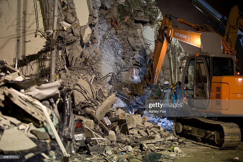 Rescue personnel search for survivors at the site of a collapsed building in the southern Taiwan on February 6, 2016 in Tainan, Taiwan. A magnitude 6.4 earthquake hit southern Taiwan early Saturday, toppling several buildings and killing at least five people in Tainan, according to local news reports.
