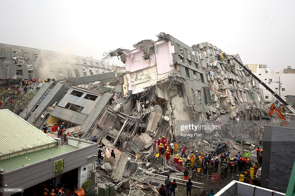 Rescue personnel search for survivors at the site of a collapsed building on February 6, 2016 in Tainan, Taiwan. A magnitude 6.4 earthquake hit southern Taiwan early Saturday, toppling several buildings and killing at least two people in Tainan, according to local news reports.