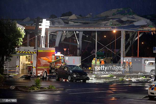 Rescue personnel survey the damage at the Albany Shopping Centre in the North Shore of Auckland on May 3 2011 after a freak tornado hit the area...