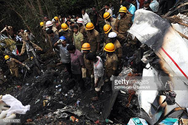 Rescue personnel work at the crash site of an Air India Boeing 737800 aircraft which crashed upon landing in Mangalore on May 22 2010 An Air India...