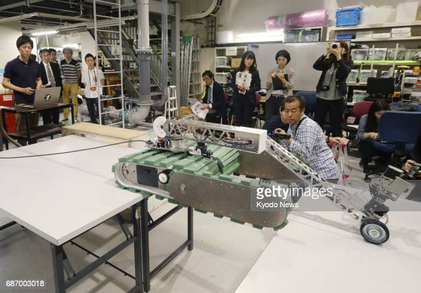 A rescue robot known as FUHGA is shown to the media at Kyoto University on May 23 2017 The winner of a domestic rescue robot competition is capable...
