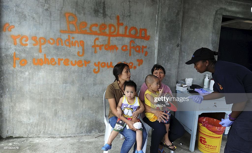 A Rescue SA team member attending to patients at the field clinic on November 20, 2013, in Abuyog, Philippines. The clinic serves the community because the hospital has been distroyed by typhoon Hyaina. The typhoon hit the Philippines on November 8, 2013, and was recorded as the second deadliest typhoon in that region.