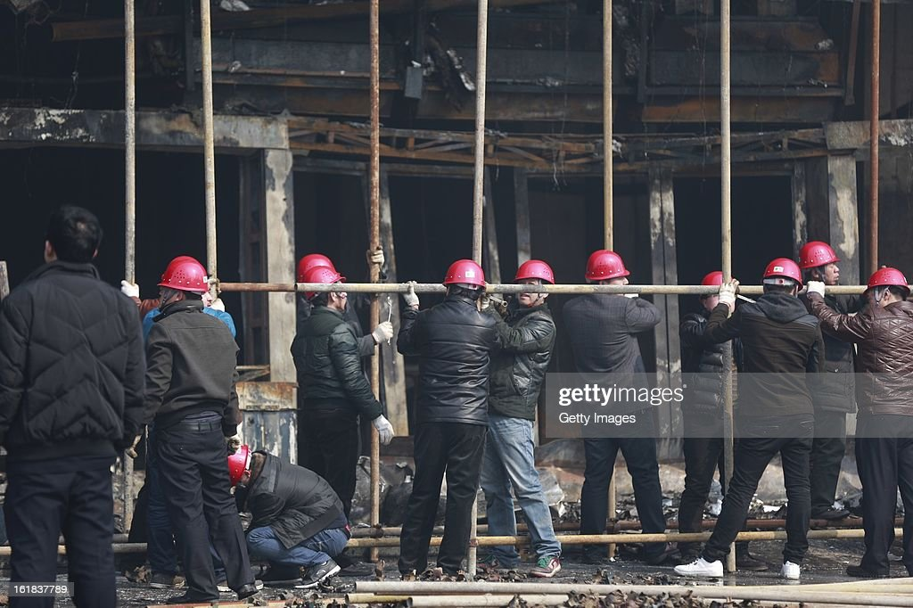Rescue services work at the site of a fire at a supermarket on February 17, 2013 in Changzhi, China. The supermarket caught fire at 4:10 a.m. today and was put out two hours later without any reports of casualties.