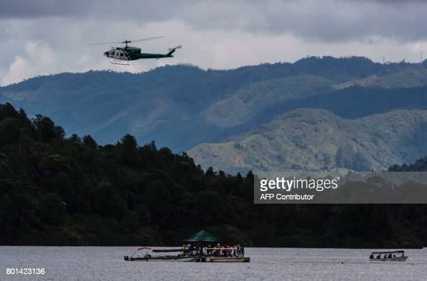Rescue staff take part in the search of bodies of victims after the tourist boat 'Almirante' sank in the Reservoir of Penol in Guatape municipality...
