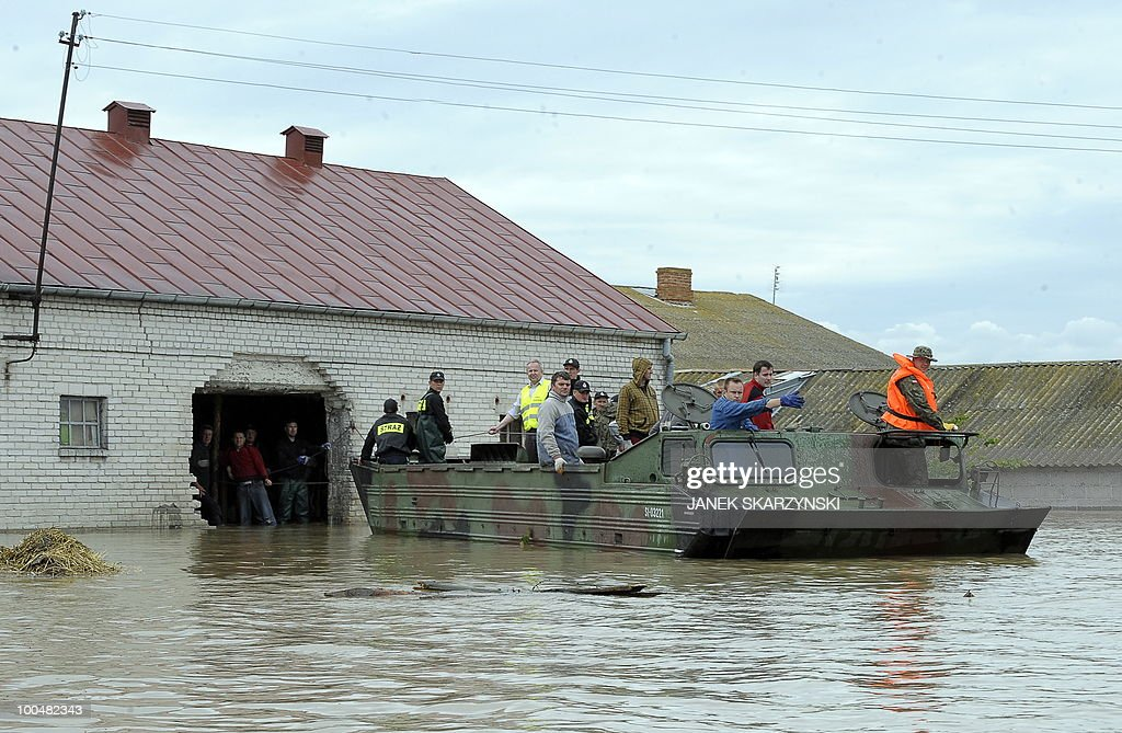 A rescue team evacuates people with an amphibious vehicle from a flooded farm in Juliszew village in central Poland at Wisla river on May 24, 2010 Flash floods caused by days heavy rainfall have hit parts of central Europe, killing at least 14 people, disrupting power supplies and forcing thousands of people from their homes.
