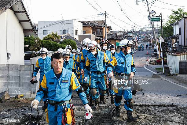 A rescue team heads for the house people are buried alive on April 16 2016 in Kumamoto Japan Following a 64 magnitude earthquake on April 14th the...