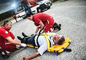 rescue team helping injured man