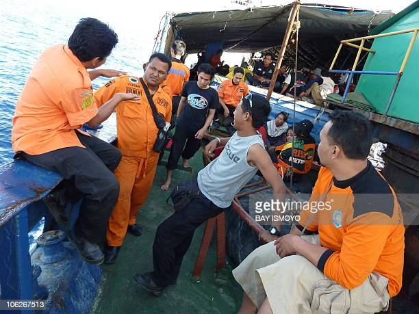 A rescue team holds a discussion on a ship headed to North Pagai island bringing relief aid and assistance to the victims of a 77magnitude quake...