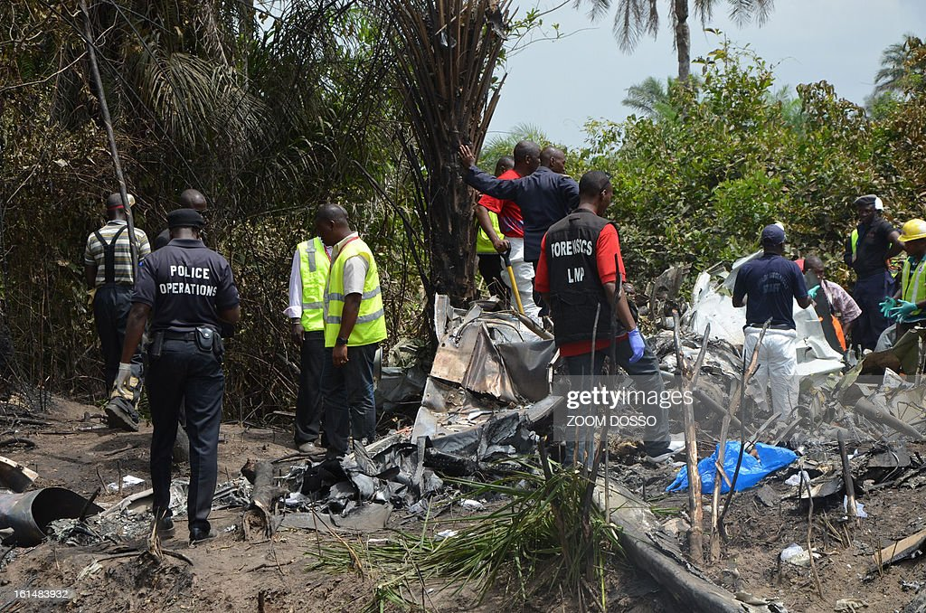 Rescue team members work on the rubble of a plane carrying a military delegation from Guinea that crashed today in the Liberian town of Charlesville, killing the army chief of staff and 10 other people, on February 11, 2013. The plane was carrying the delegation to attend an armed forces day in Liberia, which holds ceremonies each year to recognize its military and often invites officers from neighbouring countries, including Guinea.