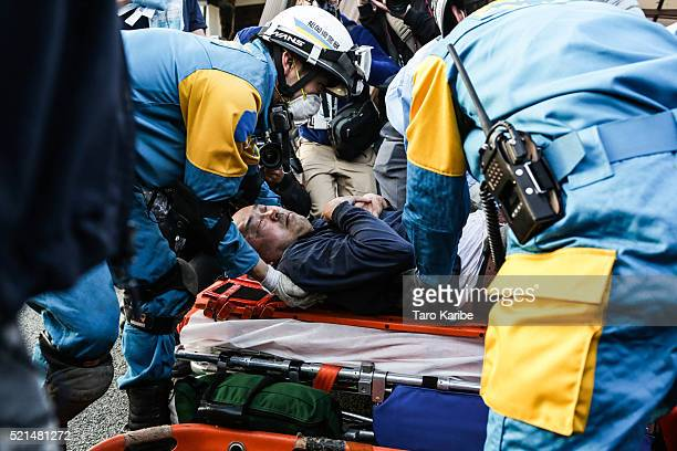 Rescue team saved a man from his house buried alive on April 16 2016 in Kumamoto Japan Following a 64 magnitude earthquake on April 14th the Kumamoto...