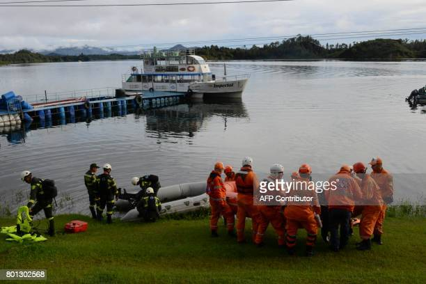 TOPSHOT A rescue team takes part in the search for survivors after the tourist boat Almirante sank in the Reservoir of Penol in Guatape municipality...