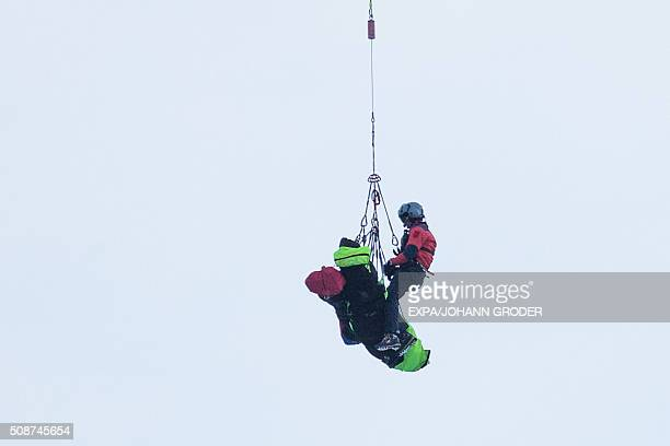 Rescue teams airlift the bodies by helicopter of a group of people buried by an avalanche at the Wattener Lizum Austria on February 6 2016 Five...