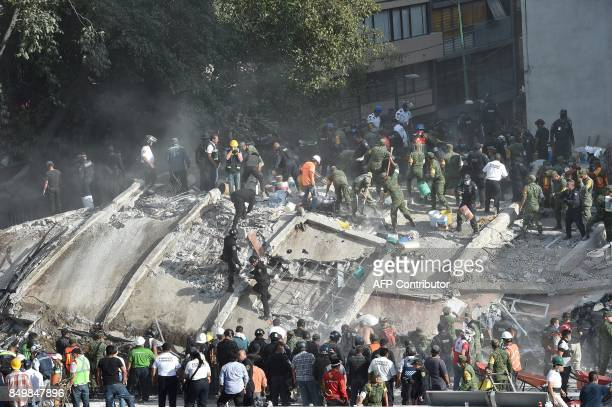Rescue teams look for people trapped in the rubble after an earthquake in Mexico City on September 19 2017 The number of people killed in a...