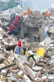 Rescue teams search for survivors May 17 2008 in Beichuan China 50000 people are estimated to have been killed in the deadliest earthquake in China...