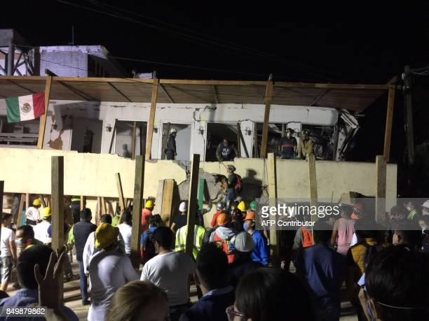 TOPSHOT Rescue teams work at the Rébsamen school in Mexico City early morning on September 20 2017 The number of people killed in a devastating...