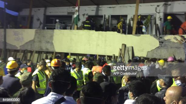 Rescue teams work at the Rébsamen school in Mexico City early morning on September 20 2017 The number of people killed in a devastating earthquake...