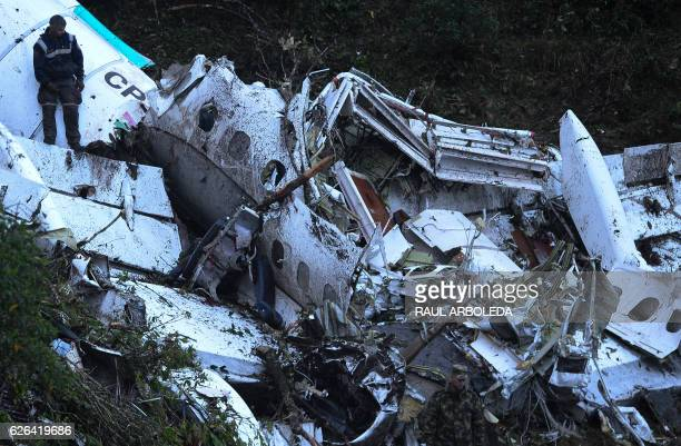Rescue teams work in the recovery of the bodies of victims of the LAMIA airlines charter that crashed in the mountains of Cerro Gordo municipality of...