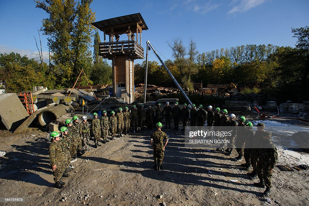 Rescue troops are pictured at the end of an exercice at a Swiss military base on October 16, 2013 in Bremgarten.
